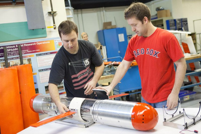Students working on an underwater glider