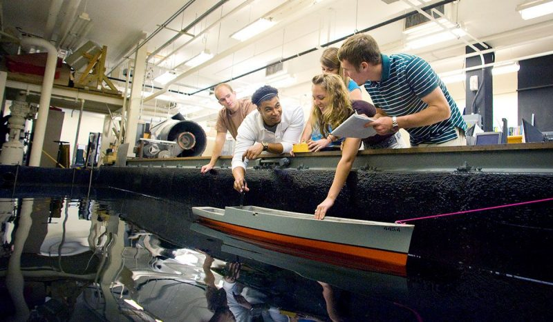 Students testing a hull design for a ship