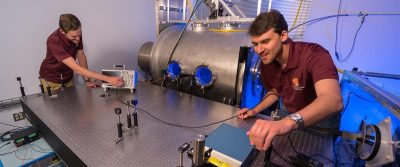 Student researchers engage in fundamental and applied plasma physics experiments using AOE's state-of-the-art facilities, including the plasma vacuum chamber.