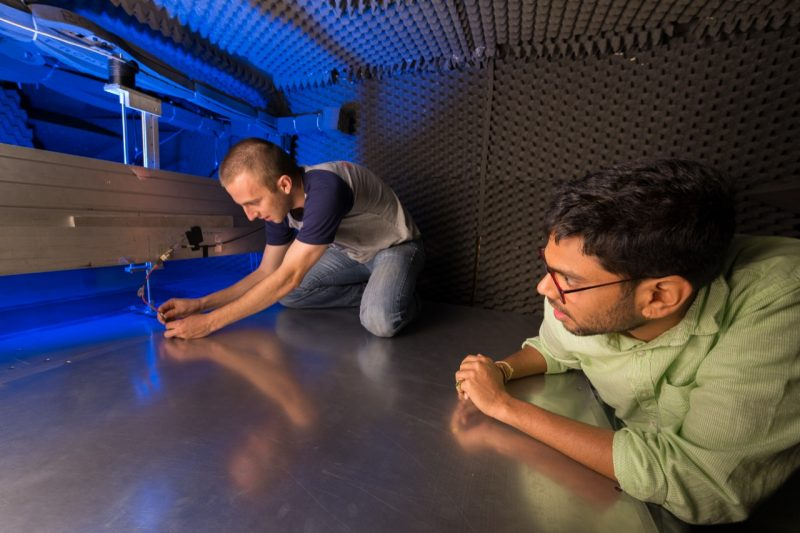 Graduate students Bennett Witcher(left) and Agastya Balantrapu (right) work in the Anechoic Wall Jet Wind Tunnel.