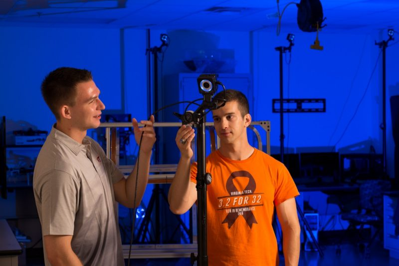 VT AOE students Larry Hensley and Mark Mercier work with a turn-key 3D positioning system.