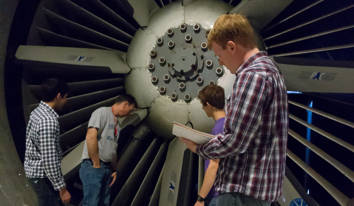 AOE students with a large turbine.