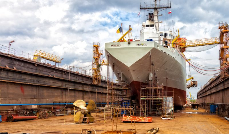 A ship being built in a drydock