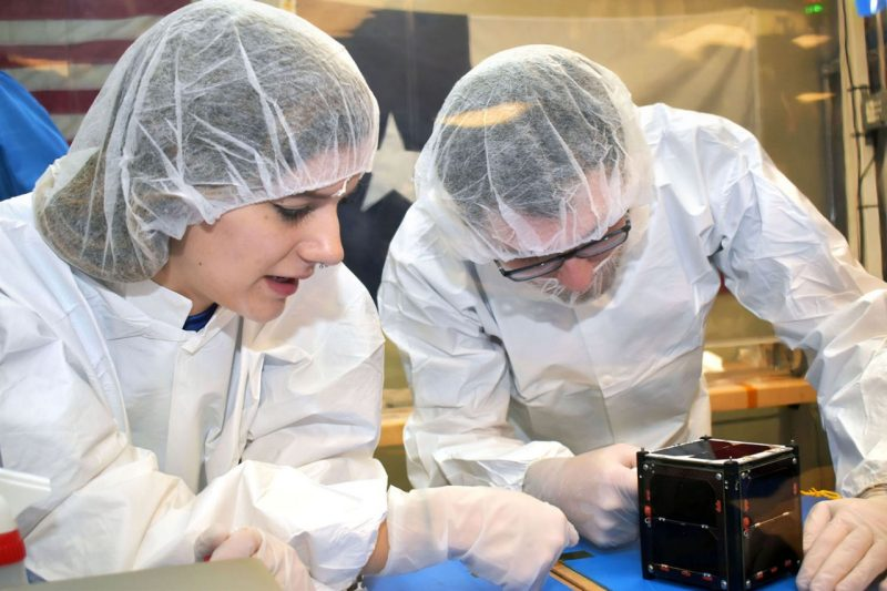 Students work on manufacturing and assembly of Virginia Tech's CubeSat satellite at Space@VT.